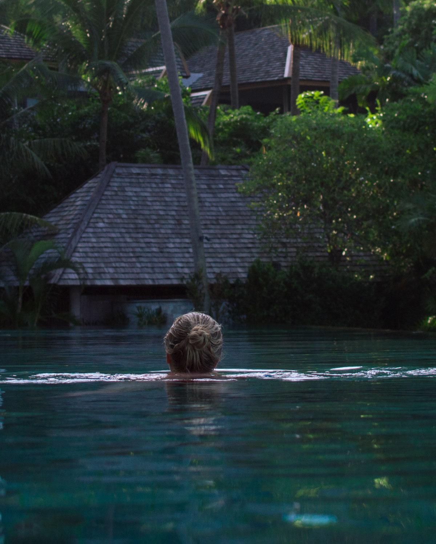 Woman swiming in the pool at Four Seasons, Koh Samui, Thailand